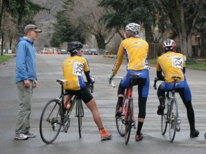 Coach Matt Shriver give's instruction to Men's B riders before the crit.