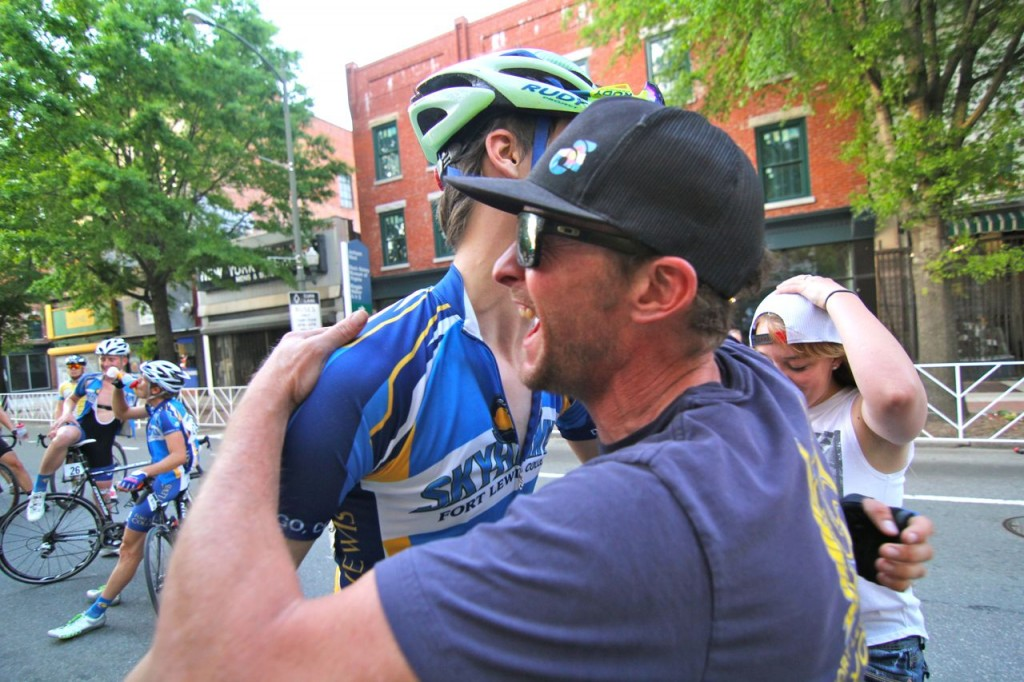 Director Dave Hagen gives Zack Noonan an emotional post race hug after a dominant FLC finish in the mens road race.